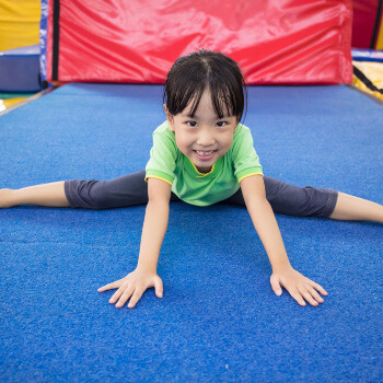 This girl is doing the splits - gymnastics has really improved her flexibility.