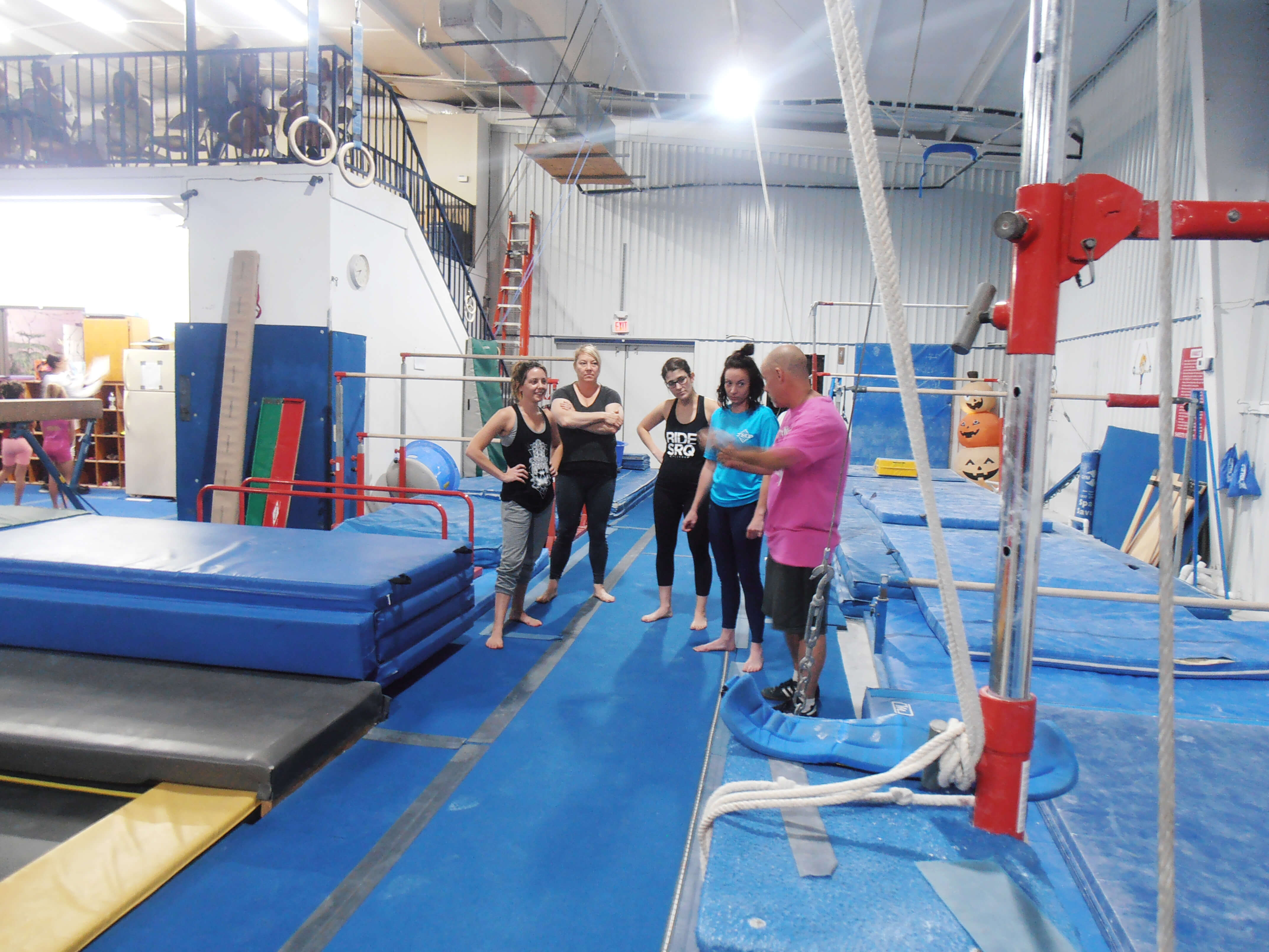 Men and Women learn gymnastics.