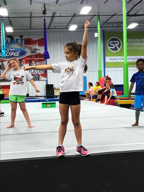 Young girls in beginner cheer class.