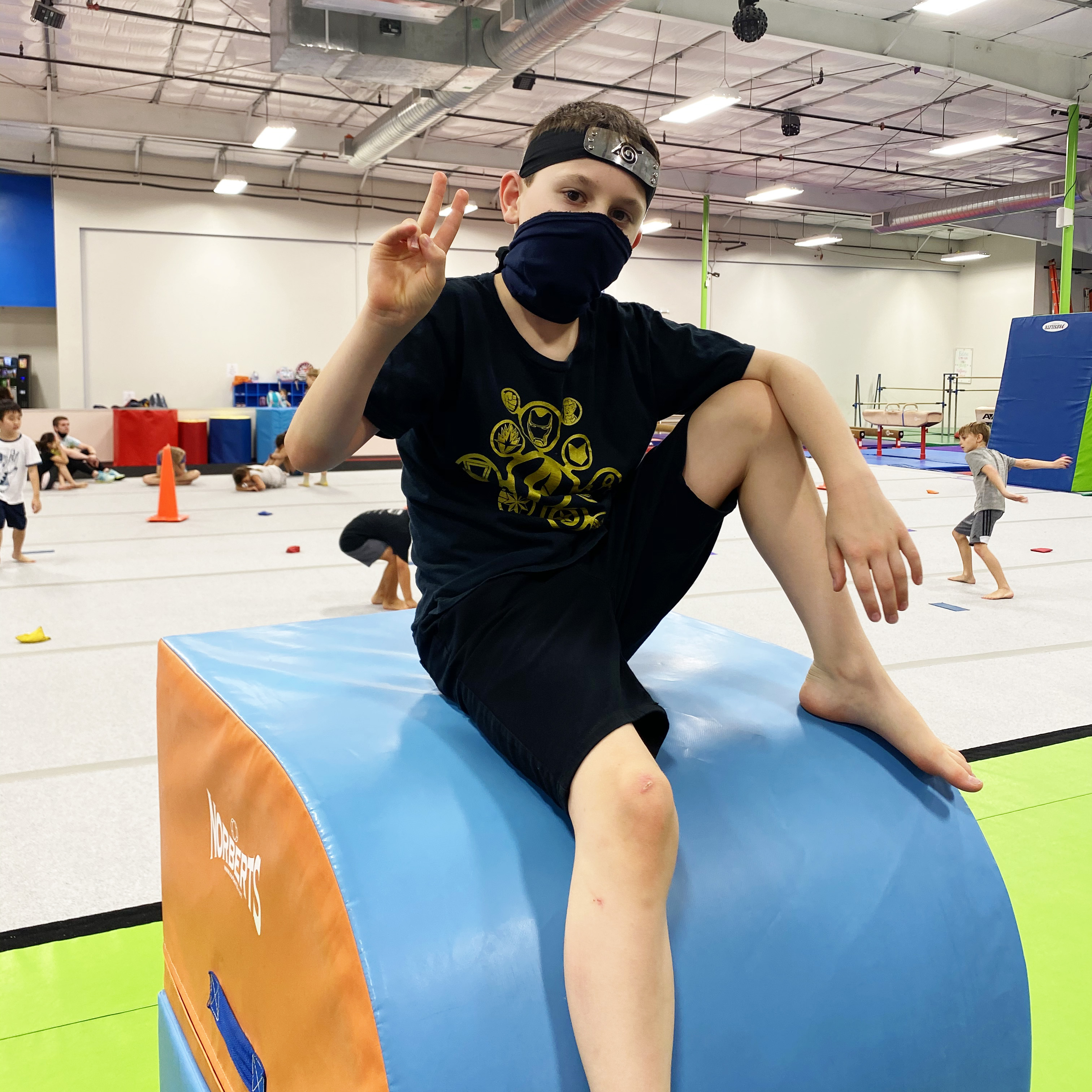 A young ninja enjoys ninja warrior camp.