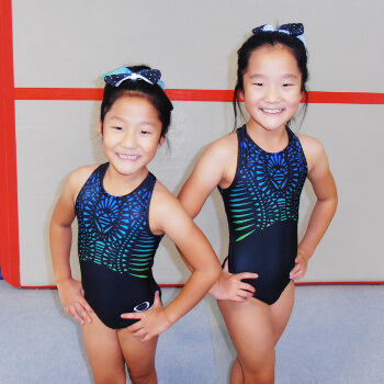 Two girls ready for their competitive meet.